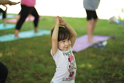 Girl doing yoga in park